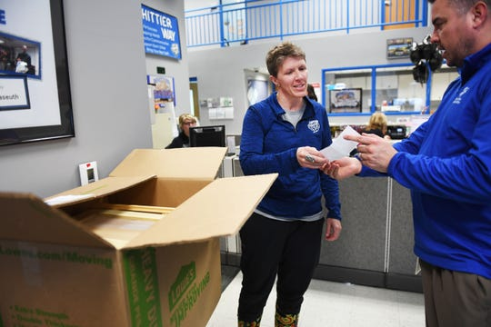 Tony Martinet, Sioux Falls Education Association President, delivers s Little Free Library to Whittier Middle School's principal Jayne Zielenski Friday, March 1, in Sioux Falls. The Sioux Falls Education Association also gave a check to each school so they could buy supplies to decorate their Little Free Library.