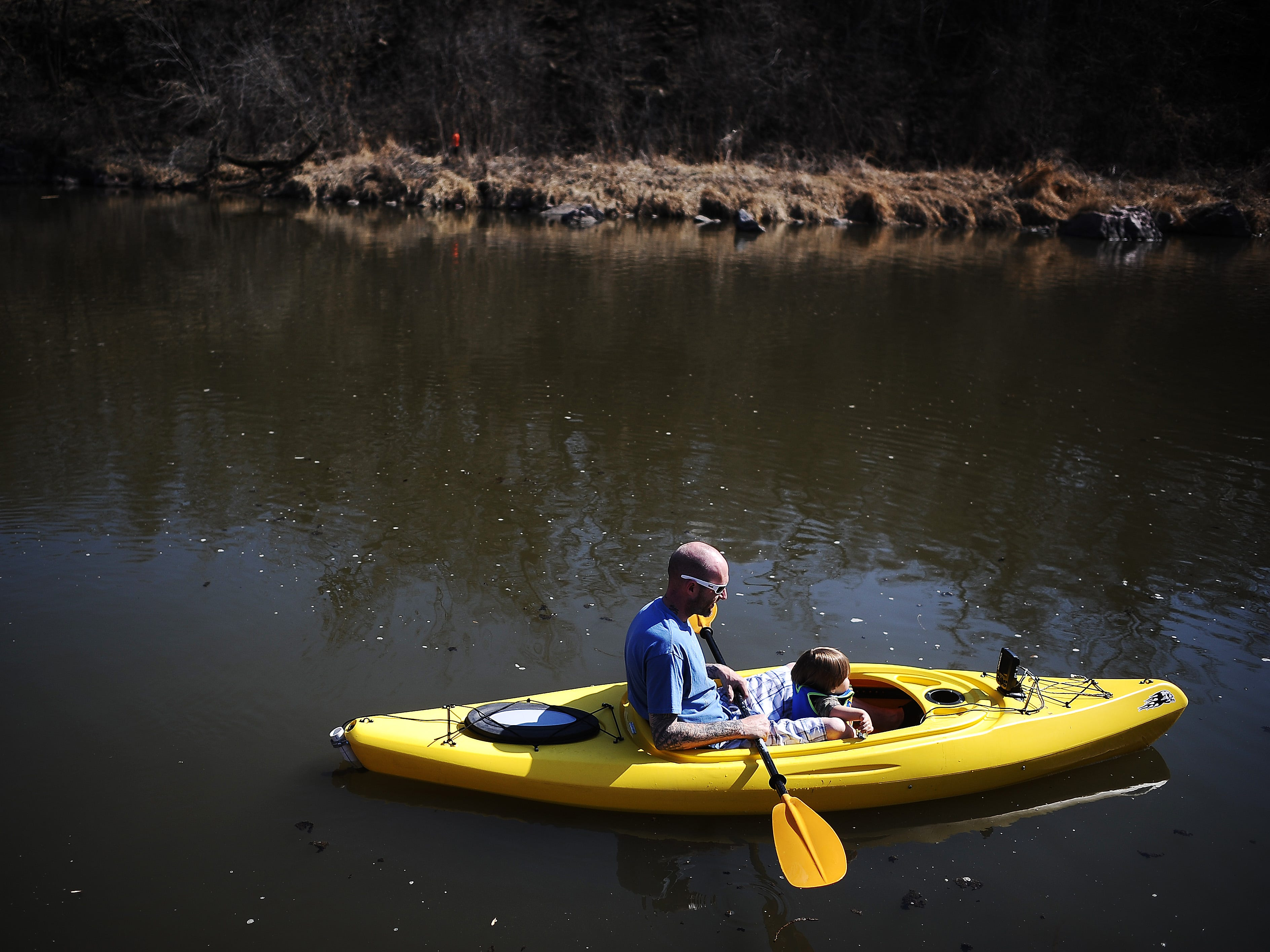 Jason Story and 1-year-old Micah Story kayak through Split Rock Creek on Sunday, April 6, 2014, at Palisades State Park near Garretson, S.D. According to the National Weather Service in Sioux Falls, temperatures on Sunday were as high as 68 degrees.