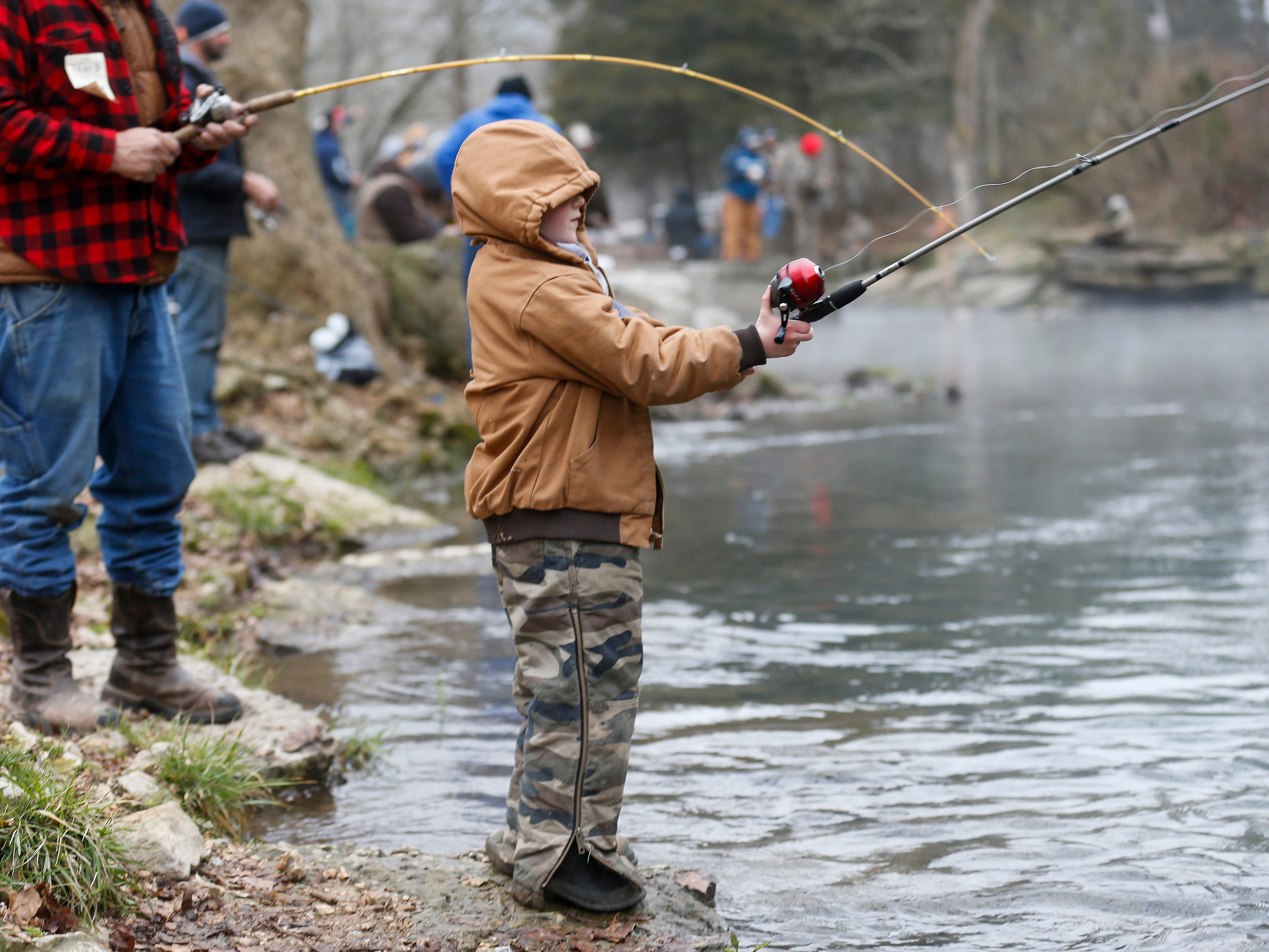 Wesley Stupperich, 6, of Diggins, MO., casts his line during opening day of trout season at Roaring River State Park on Friday, Mar. 1, 2019.