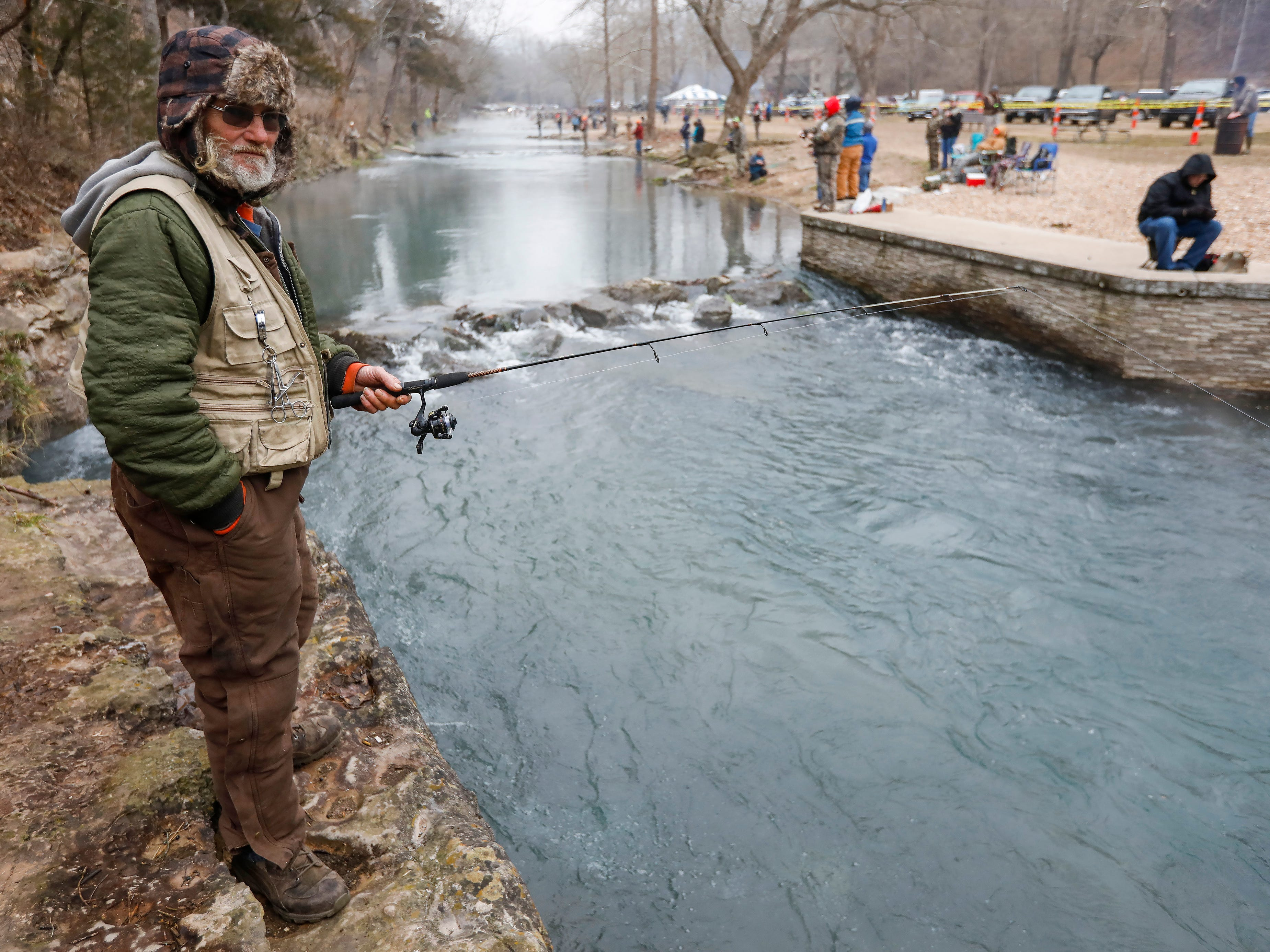 Paul Scott, of Neosho, waits for a fish to strike his lure on opening day of trout season at Roaring River State Park on Friday, Mar. 1, 2019.
