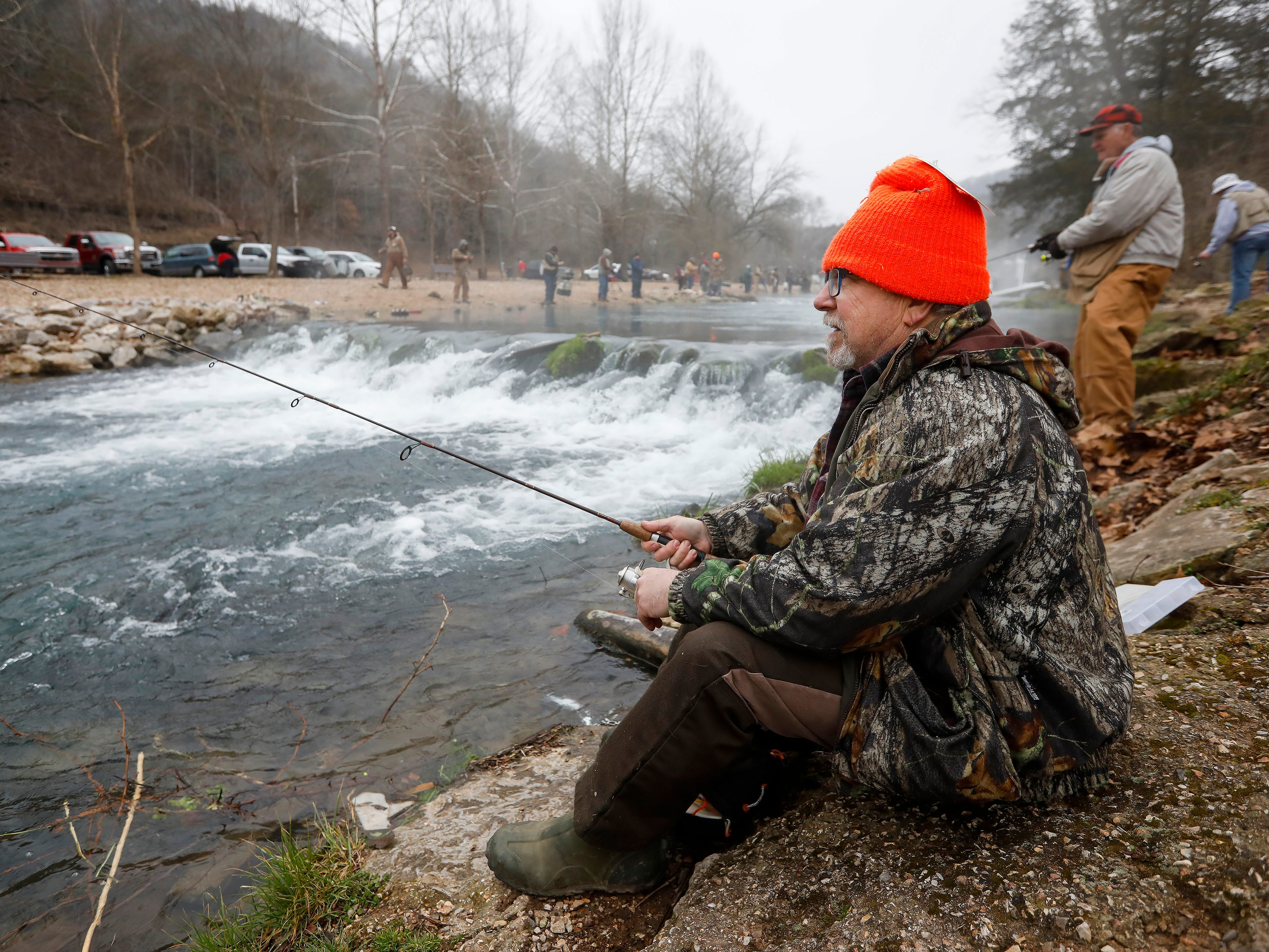 Dave Rauch, of Springfield, waits for a fish to bite on opening day of trout season at Roaring River State Park on Friday, Mar. 1, 2019.