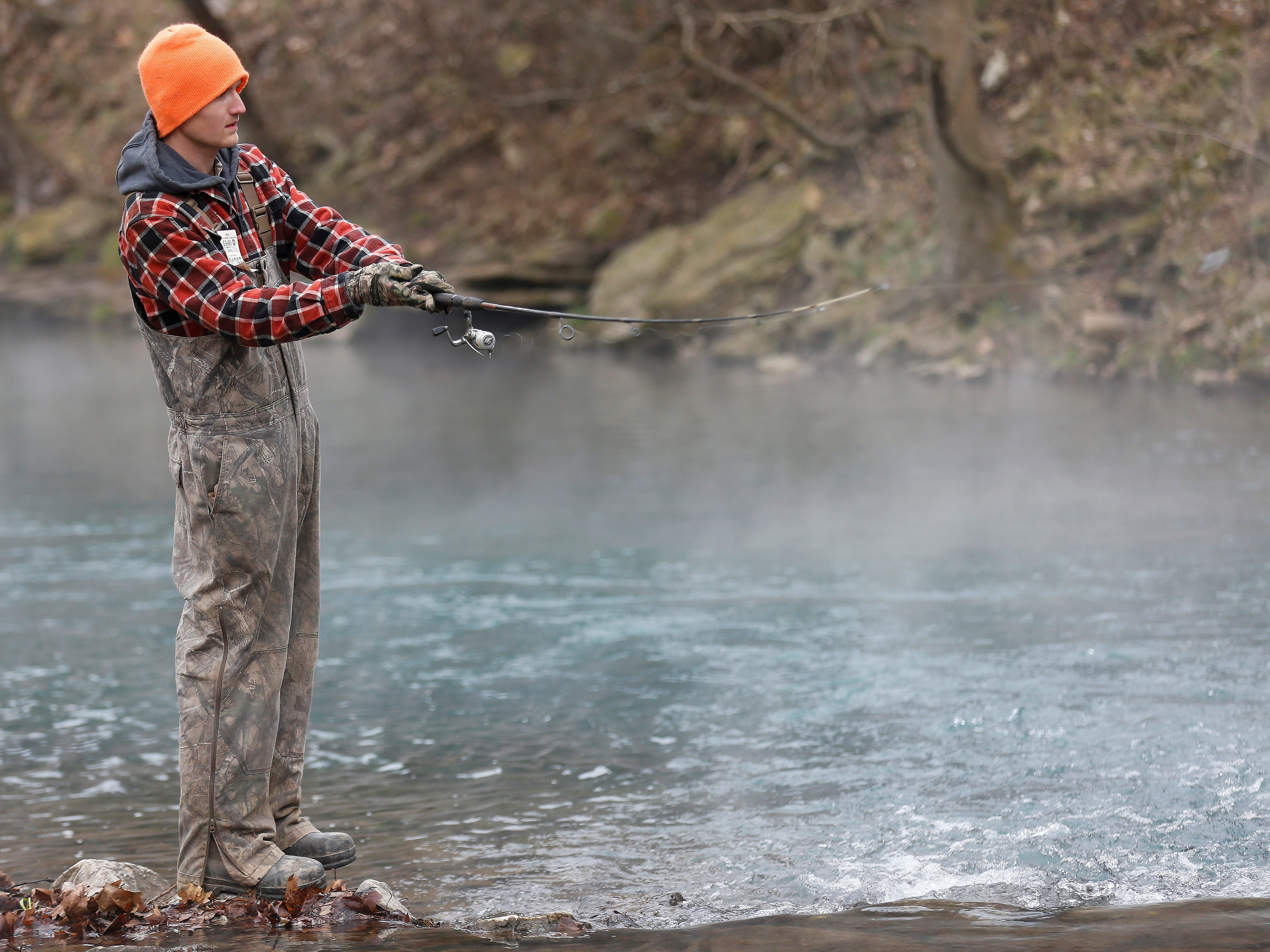 Henry Stupperich, of Diggins, MO., casts his line during opening day of trout season at Roaring River State Park on Friday, Mar. 1, 2019.