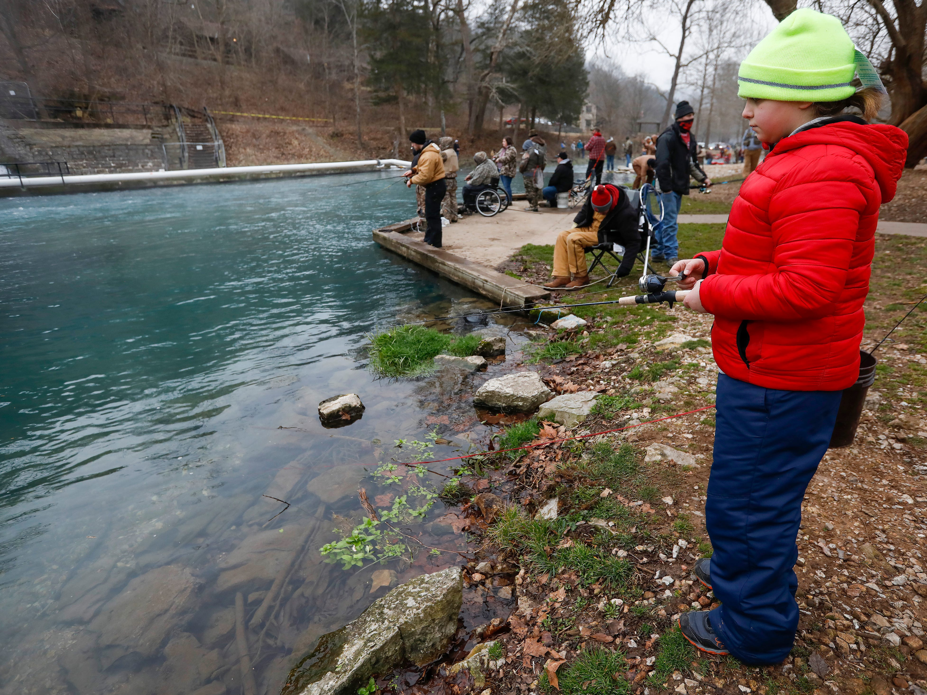 Allison Shoemaker, 9, waits for a fish to strike her lure on opening day of trout season at Roaring River State Park on Friday, Mar. 1, 2019.