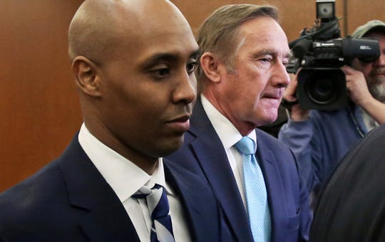 Mohamed Noor, left, former Minneapolis police officer, leaves the Hennepin County Government Center in Minneapolis Friday, March 1, 2019 with attorney Peter Wold after a hearing to address several pretrial motions.