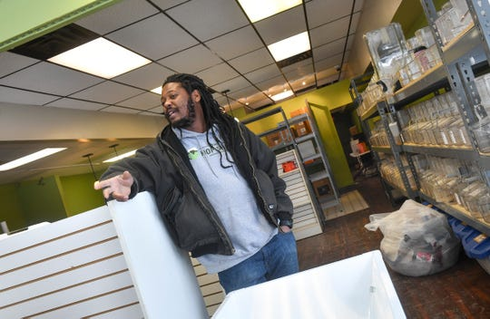The Hop Shop owner Desi Hall talks about his plans for the store's new space Friday, March 1, at 701 St. Germain St. in St. Cloud. The location was formerly occupied by Big Apple Bagels.