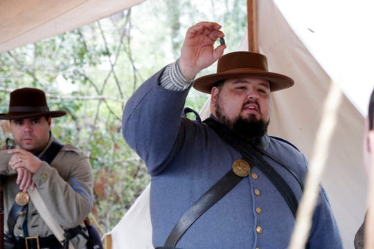Drew Bell, a sergeant with Leon Rifles, holds up a lead bullet that would have been used at the 42nd Annual Battle of Natural Bridge Reenactment, Friday March 1, 2019.
