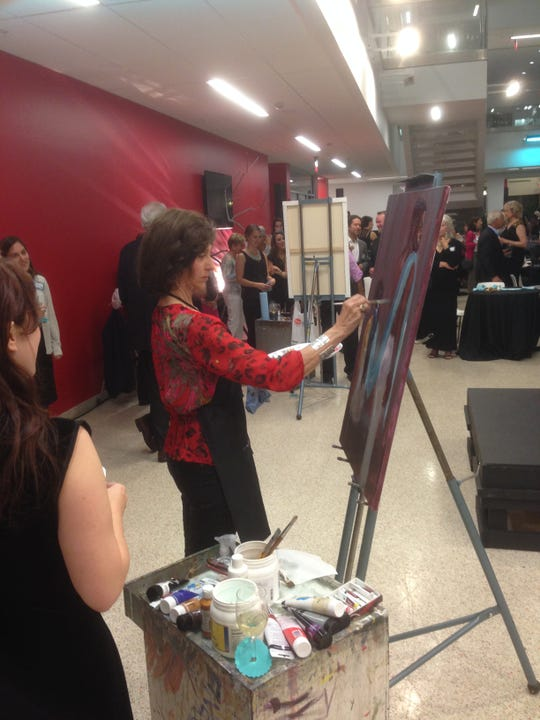 Artists, shown here in 2017, have 10-minutes each to work on five collaborative paintings at the Paint Around Gala and Auction, set for March 9 this year.
