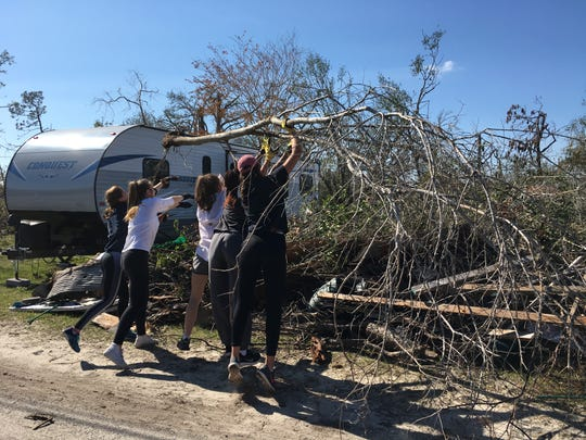 Students from John Paul II high school in Tallahassee help with post-hurricane clean-up in February.