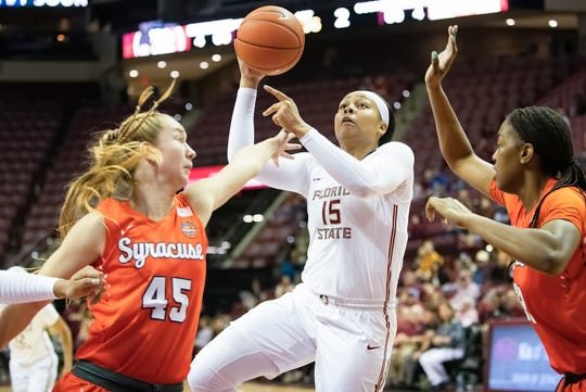 Florida State junior Kiah Gillespie drives the lane as the Seminoles take on Syracuse.