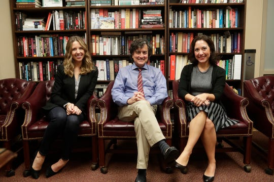 Dr. JIllian J. Turanovic, assistant professor in the College of Criminology and Criminal Justice, left, Dr. James J. Clark, dean and professor in the College of Social Work, and Dr. Amy E. Coren, assistant teaching professor in the Department of Psychology, pose for a photo Friday, March 1, 2019.