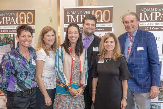 Impact 100 named three grant recipients Feb. 28, 2019. From left to right: Amy Acker, Impact 100 president-elect; Brenda Cetrulo, grants chair; Jacque Petrone, HALO No Kill Rescue; Aaron Collins, Space Coast Symphony; Denise Battaglini, Impact 100 president; Bill Munn, board co-chairman, Boys & Girls Club.
