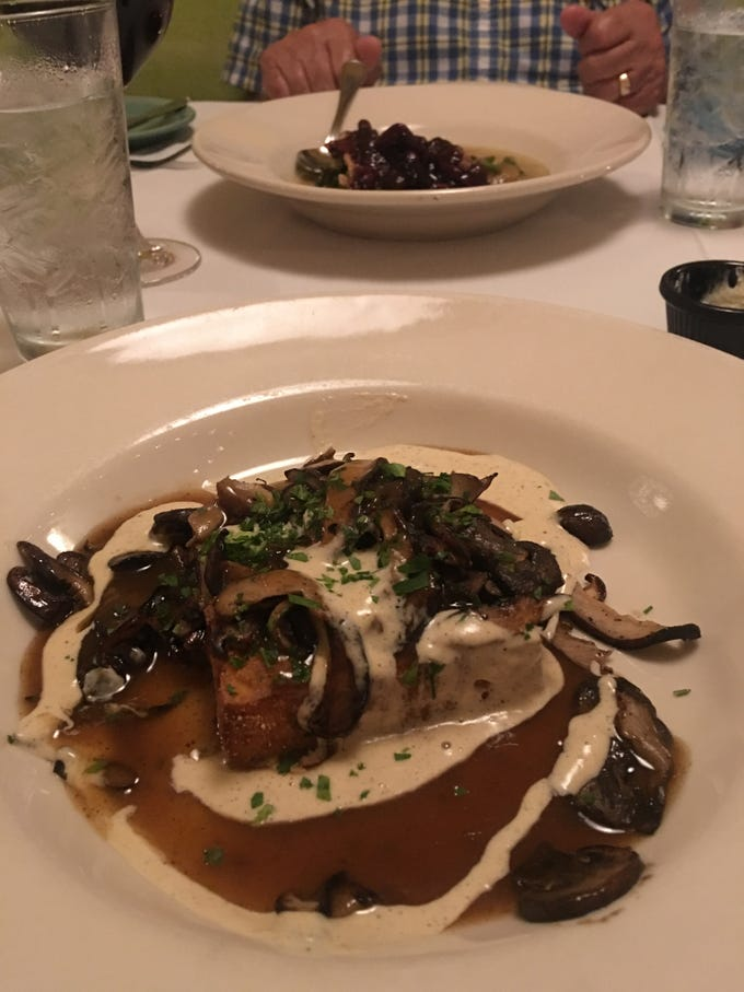 Fire and Wine griddled seasonal mushrooms on seared polenta with short rib jus and a brie drizzle tasted as amazing as it sounds.