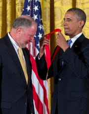 President Barack Obama awards Robert Putnam the 2012 National Humanities Medal during a ceremony in the East Room of White House in Washington, Wednesday, July 10, 2013. Putnam received the medal for deepening our understanding of community in America. Examining how patterns of engagement divide and unite.