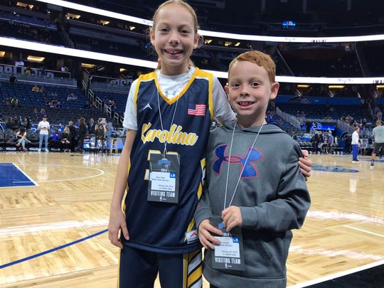 Karolina Ramirez, 10, and her brother, Adrian, stand court-side before the Orlando Magic-Golden State Warriors game Thursday, Feb. 28, 2019, in Orlando. Karolina's favorite player is Stephen Curry, of the Warriors.