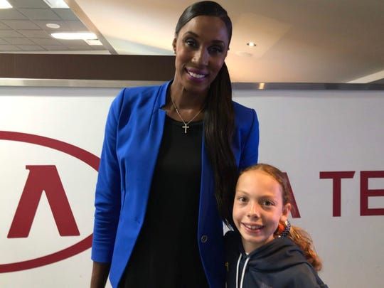 Lisa Leslie, a former WNBA player, poses with Karolina Ramirez, 10, of Stuart, before the Orlando Magic-Golden State Warriors game Thursday, Feb. 28, 2019.