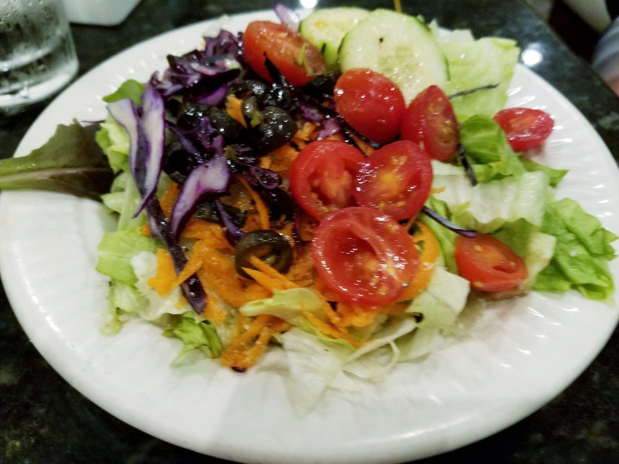 The house salad had a crisp lettuce blend with plenty of fresh vegetables in a tart Italian dressing.