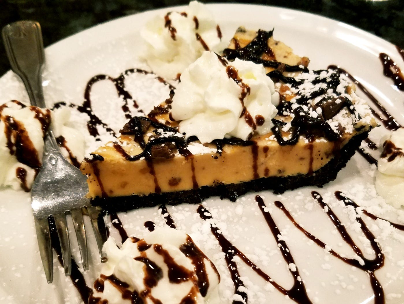 The peanut butter pie sat on a chocolate cookie crust with a filling of rich peanut butter studded with chocolate chips.
