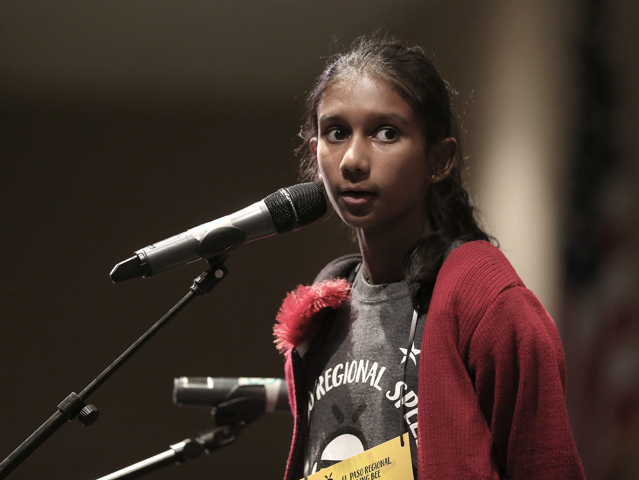 Sheneli de Silva listens for her word at the 2019 El Paso Regional Spelling Bee Friday at Bowie High School.