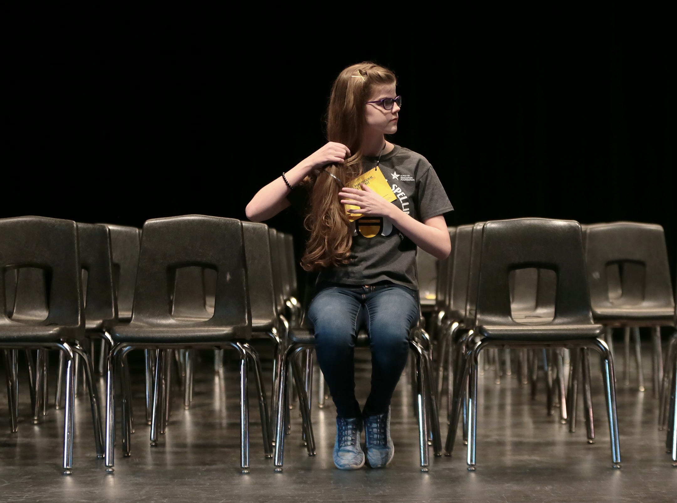 Alexia Whetten of Canutillo Middle School waits for round 2 to begin at the 2019 El Paso Regional Spelling Bee Friday at Bowie High School.