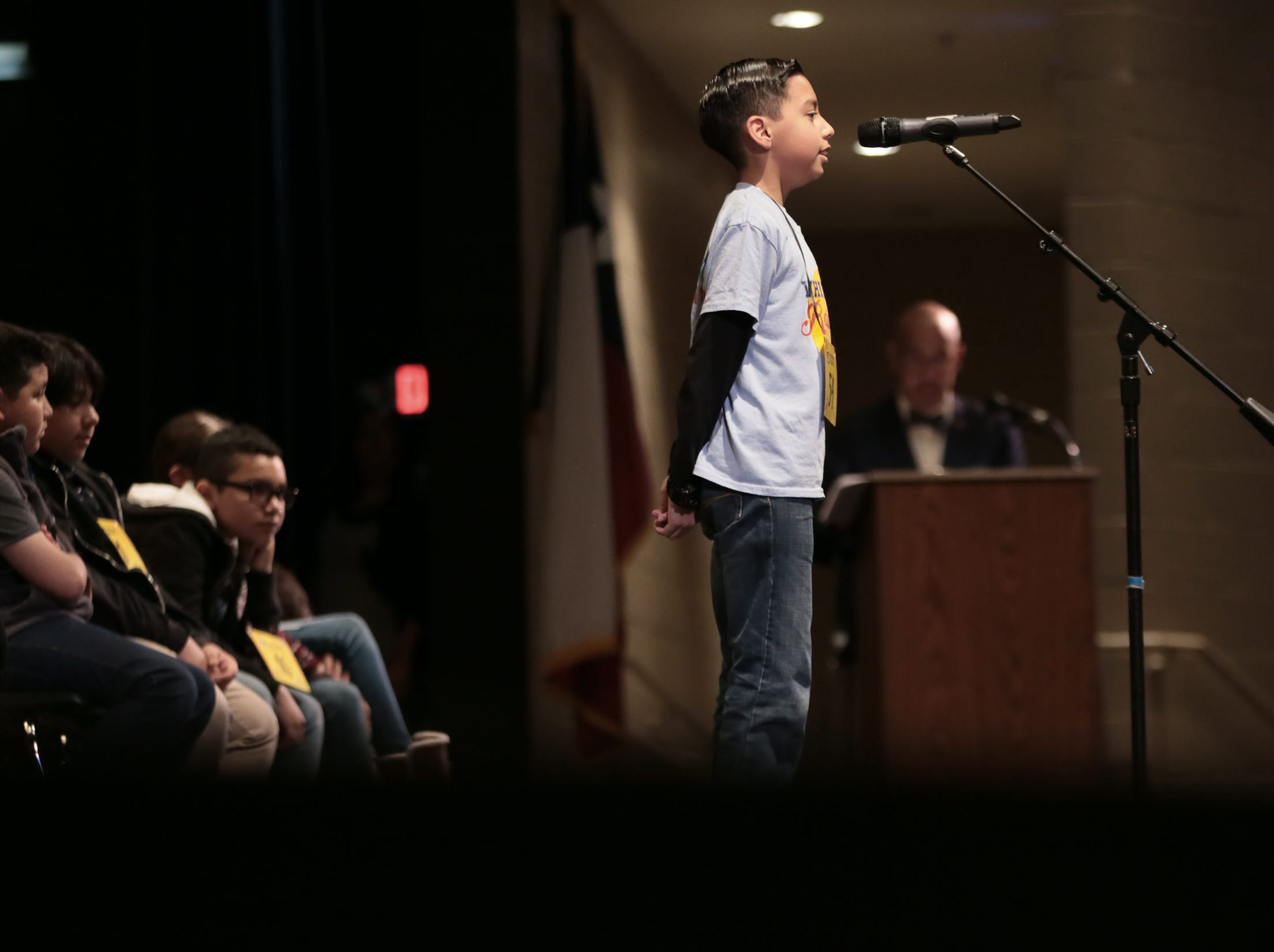 Freddo Alejandre steps up to the mic at the 2019 El Paso Regional Spelling Bee Friday at Bowie High School.