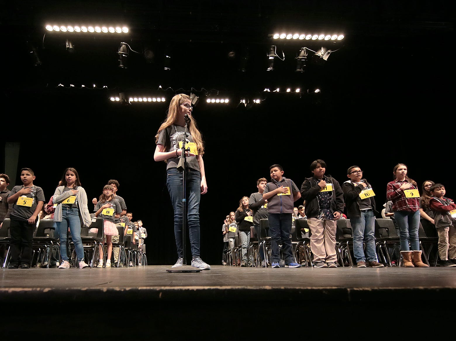 Alexia Whetten leads the auditorium in the Pledge of Allegiance at the 2019 El Paso Regional Spelling Bee on Friday, March 1, 2019, at Bowie High School.