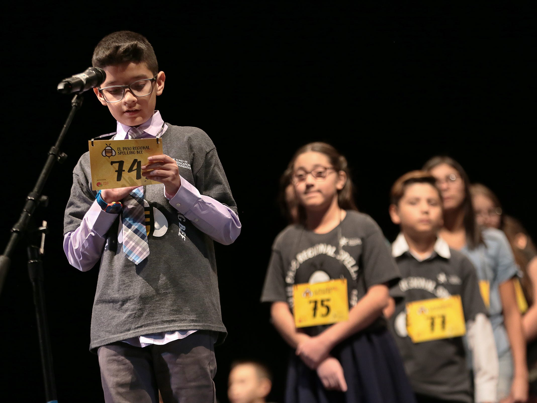 Andy Diaz of Mission Valley Elementary School spells on the back of his number at the 2019 El Paso Regional Spelling Bee Friday at Bowie High School.