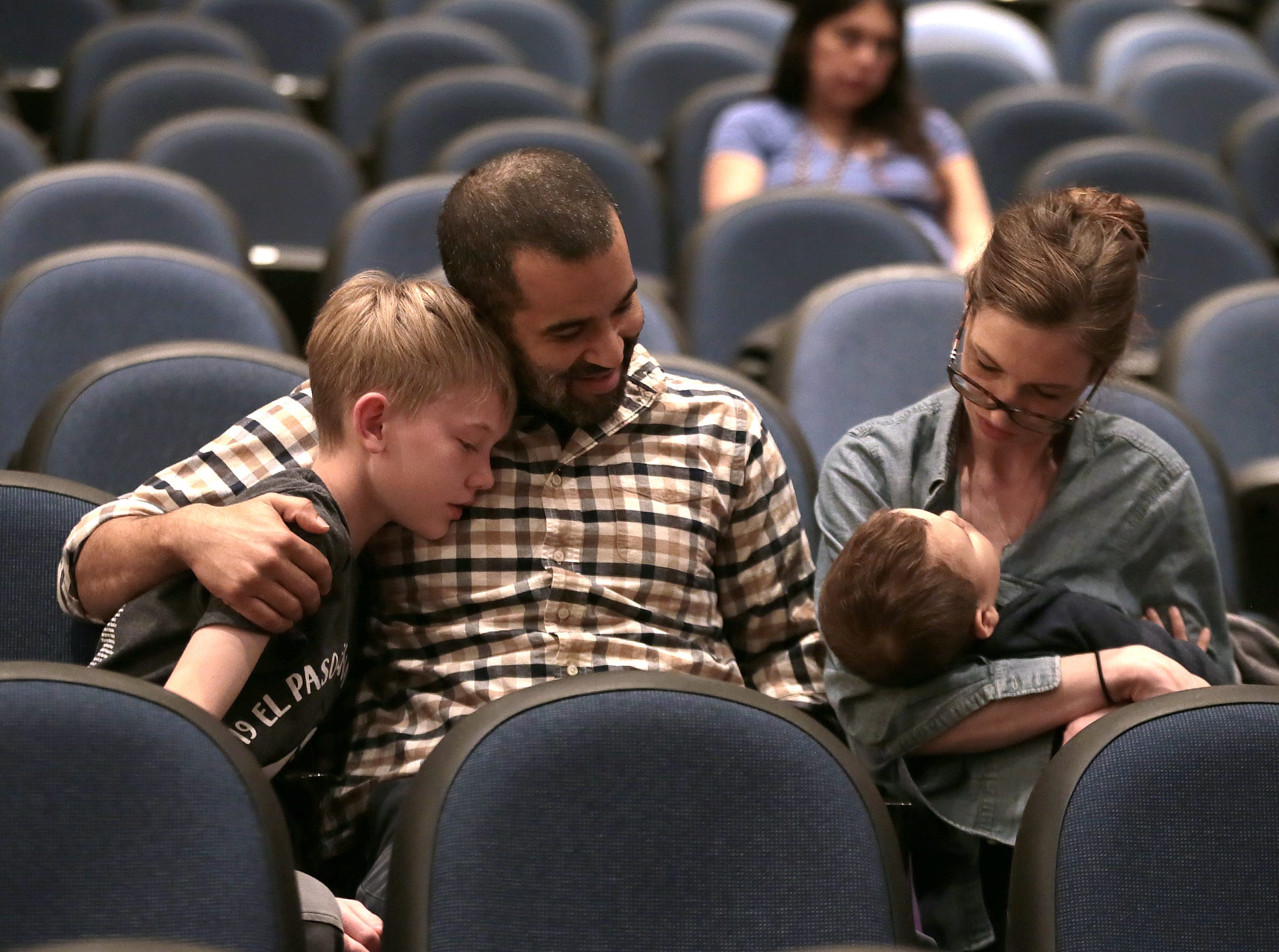James Berning gets love from his family after being eliminated at the 2019 El Paso Regional Spelling Bee Friday at Bowie High School.