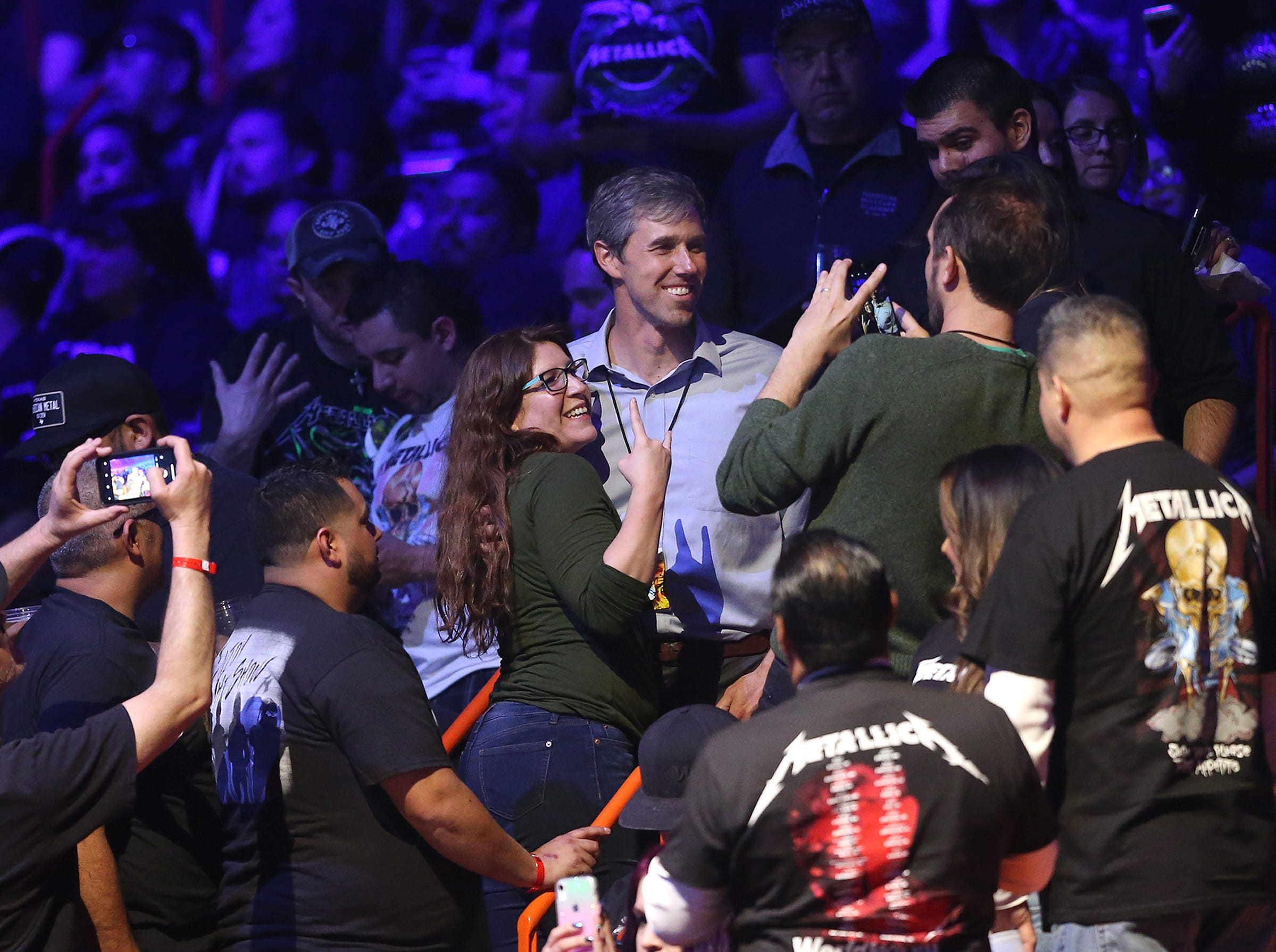 Beto O'Rourke takes photos and shakes hands in the crowd at the Metallica concert Feb. 28 at the Don Haskins Center.