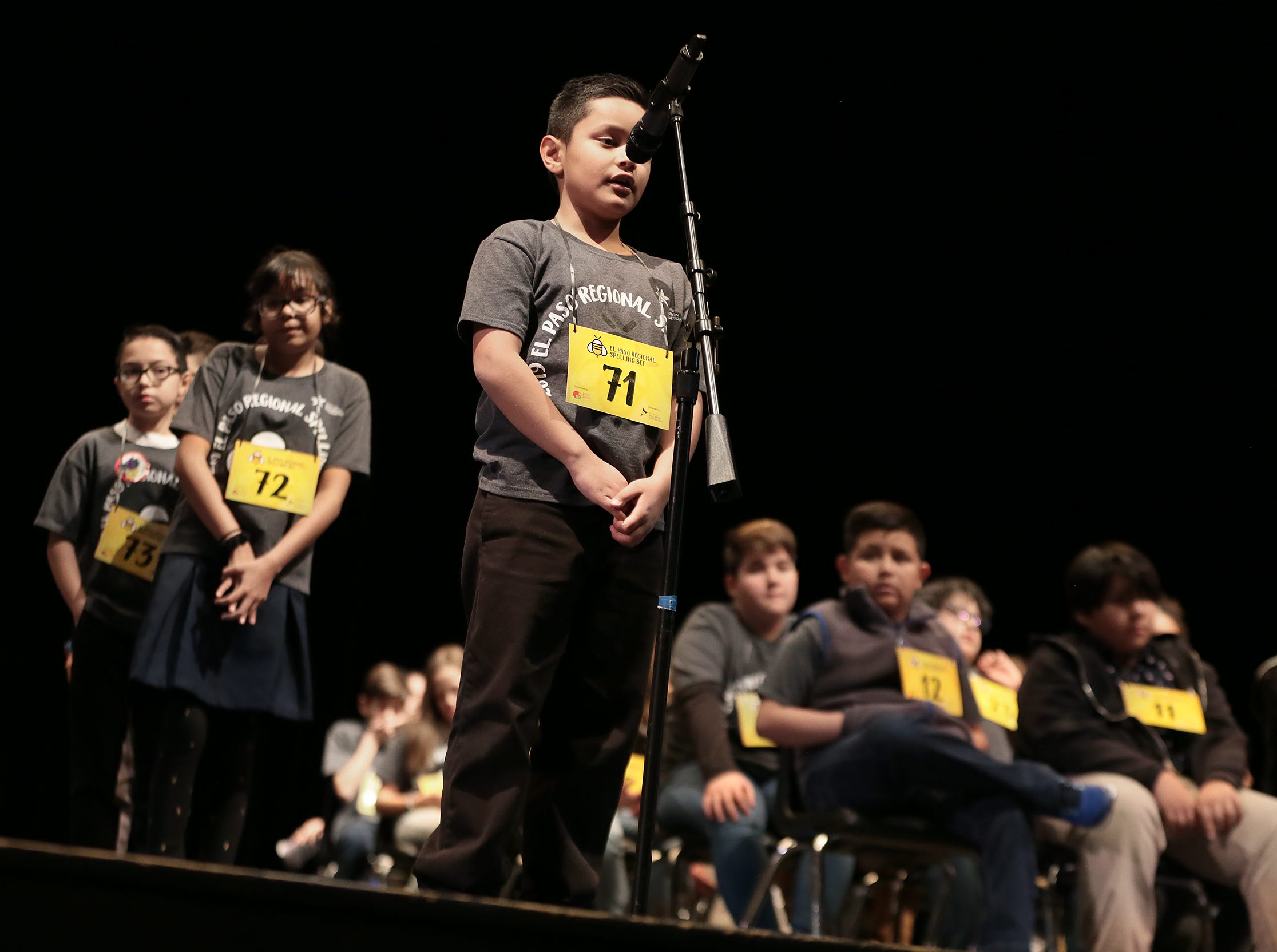 Josiah Navarro of Glen Cove Elementary School spells his word at the 2019 El Paso Regional Spelling Bee Friday at Bowie High School.