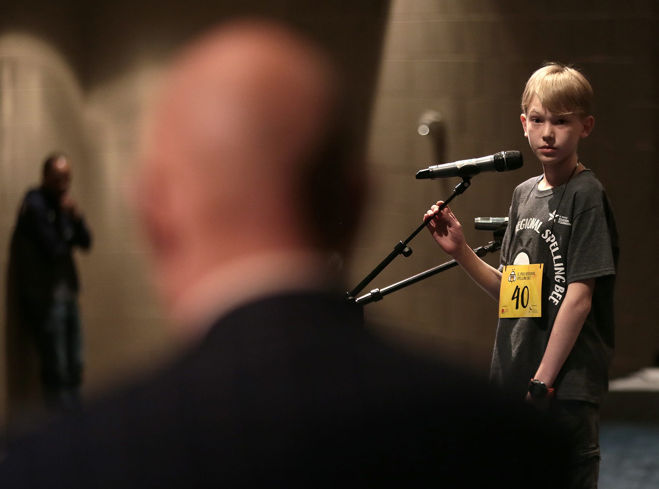 James Berning of Lundy Elementary School listens to pronouncer Dr. Richard Pineda at the 2019 El Paso Regional Spelling Bee Friday at Bowie High School.