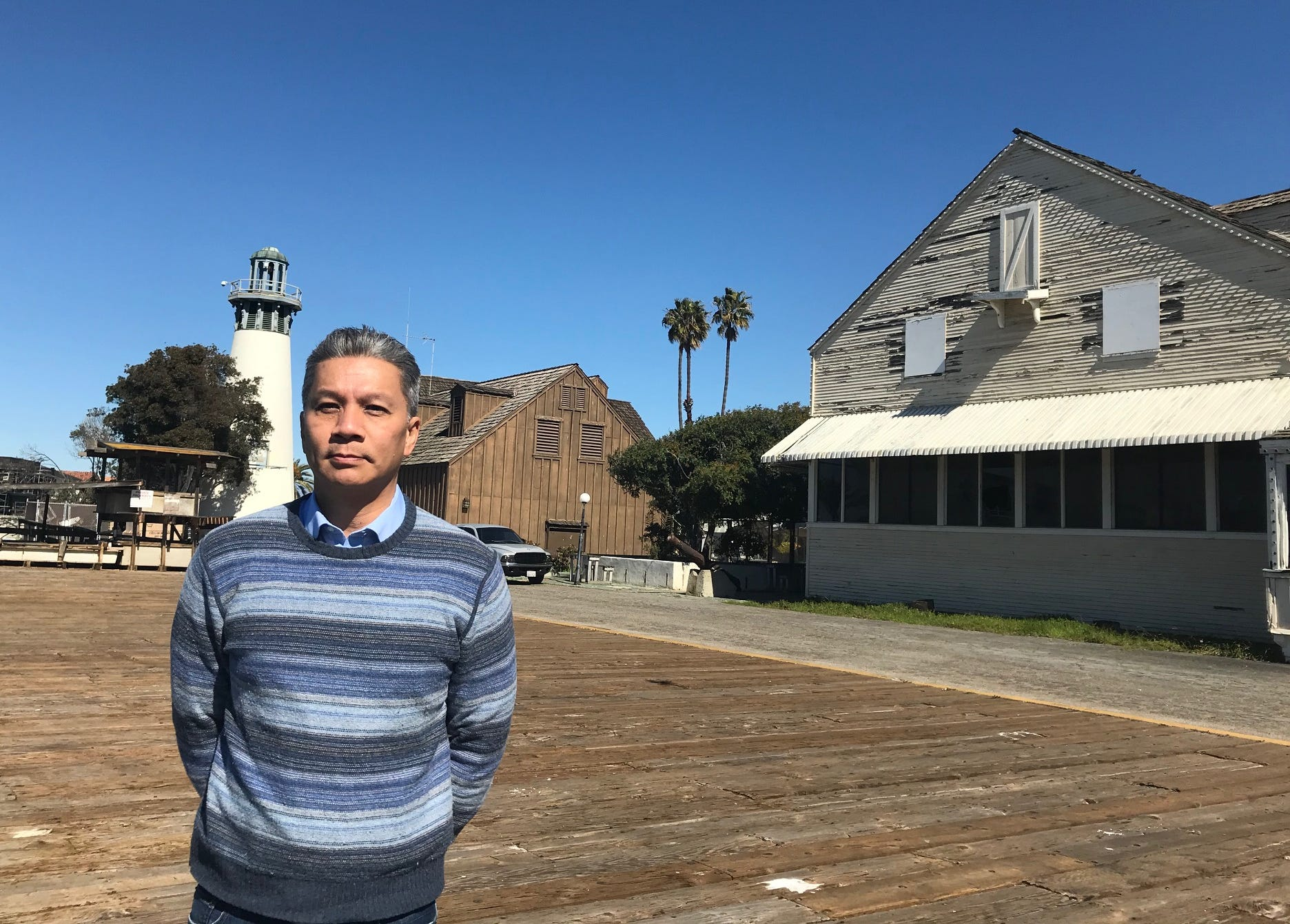Oxnard City Manager Alex Nguyen visits Channel Islands Harbor, where a dispute has erupted between the city and Ventura County over costs to keep up parks and parking lots near the harbor.