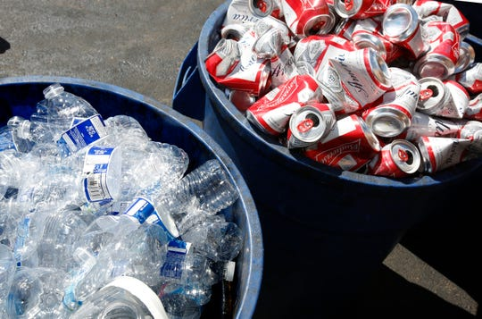 This July 5, 2016, file photo shows cans and plastic bottles brought in for recycling in Sacramento. California consumers are losing out on millions in deposits on cans and bottles, largely because it's increasingly difficult to find a recycling center.