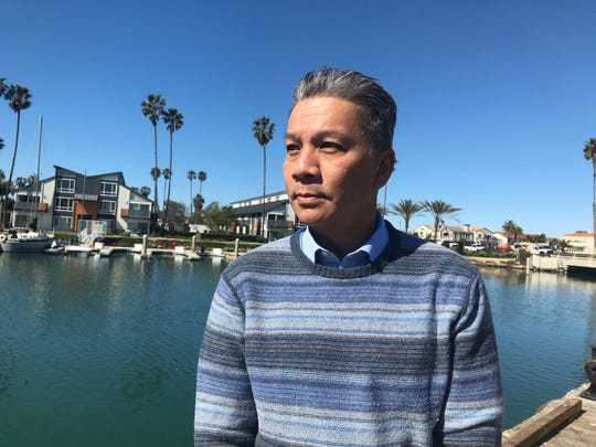 Oxnard City Manager Alex Nguyen visits Channel Islands Harbor where a dispute has erupted between the city and Ventura County over costs to keep up parks and parking lots near the harbor.