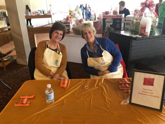 Betsy Roberts and Robin Freitag sell tickets during the Soroptimist International of Cumberland County Bingo event.