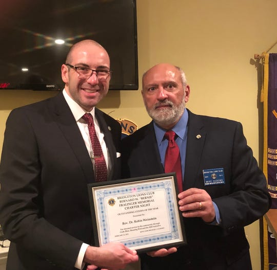 Mike Cudemo (right), president, Bridgeton Lions Club, recently presented Robin Weinstein, with the first Bernie Fralinger Memorial Outstanding Citizen of the Year Award. Weinstein spoke to the group about the team effort and support for the M25 Initiative and Code Blue. In addition to the award, Cudemo presented a donation for the M25 Initiative to Weinstein.Bernie Fralinger was an active, longtimemember of the Bridgeton Lions Club.