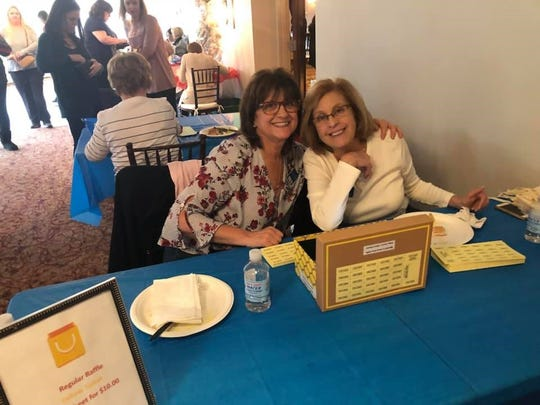 Carole Fischer (left) and Debby Brooks sell tickets during the Soroptimist International of Cumberland County Bingo event.
