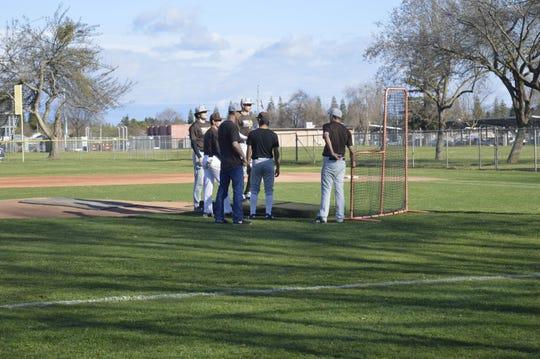 Golden West High School baseball players prep for practice on Thursday at Dick Doepker Field.