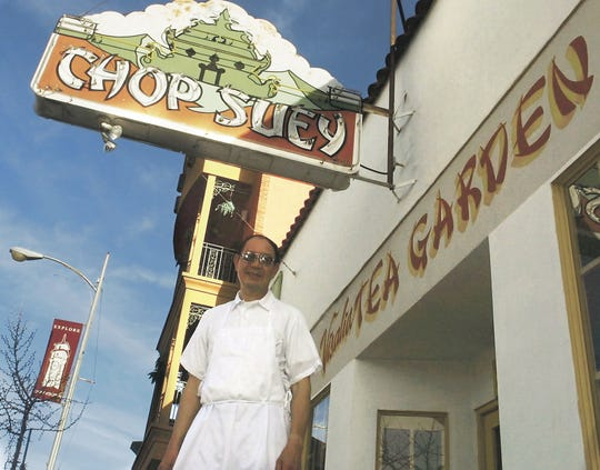 Albert Young stands in front of the Visalia Tea Garden Chinese restaurant on East Main Street in this 2010 file photo. The Visalia Tea Garden, Tulare County's oldest restaurant, has closed after nearly a century downtown.