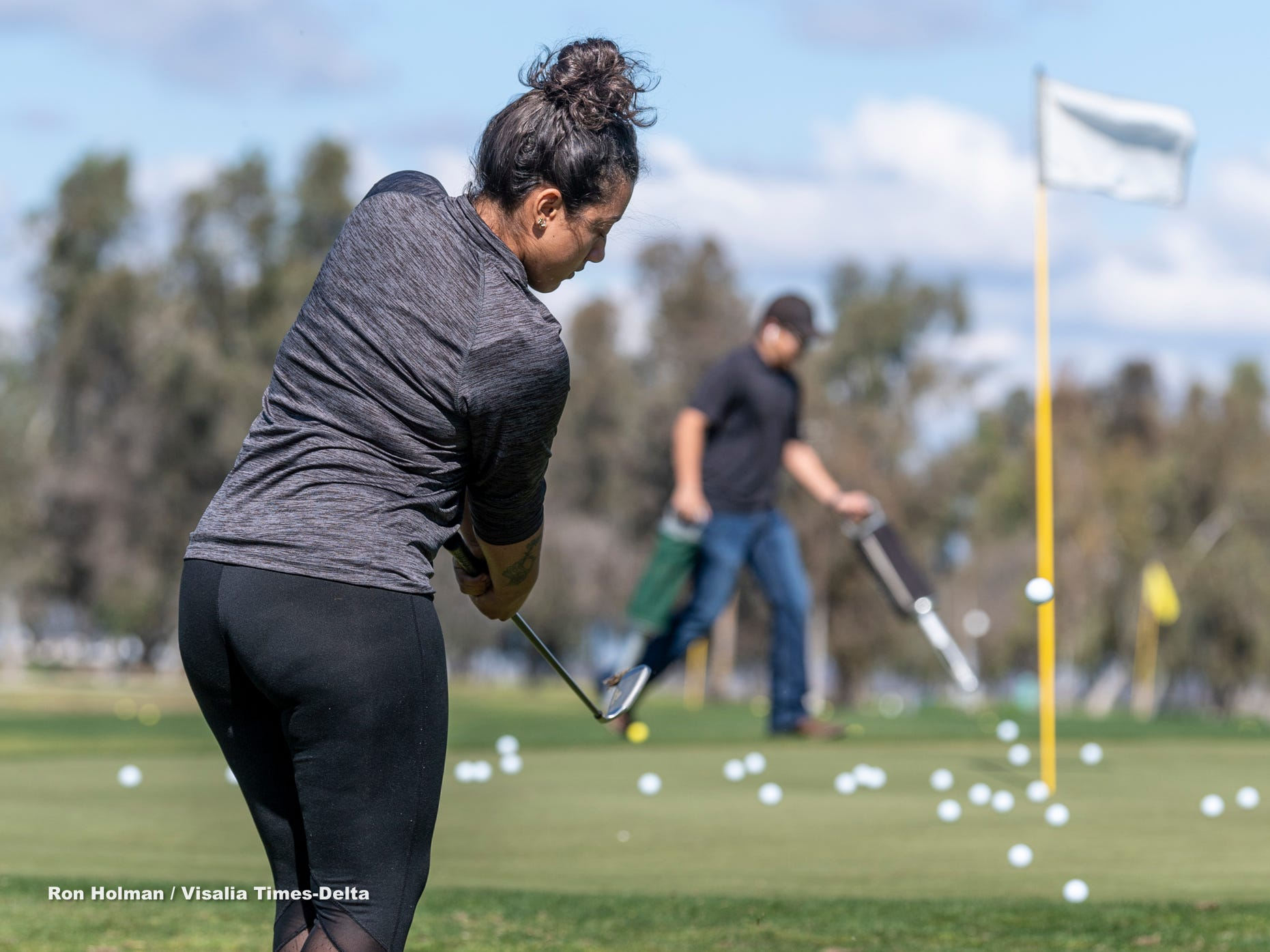 Mission Oak's Trynity King practices during a golf clinic for female golfers of all ages on Thursday, February 28, 2019. Organizers held the free event at the Tulare Golf Course to help grow the game of golf in the Central Valley.