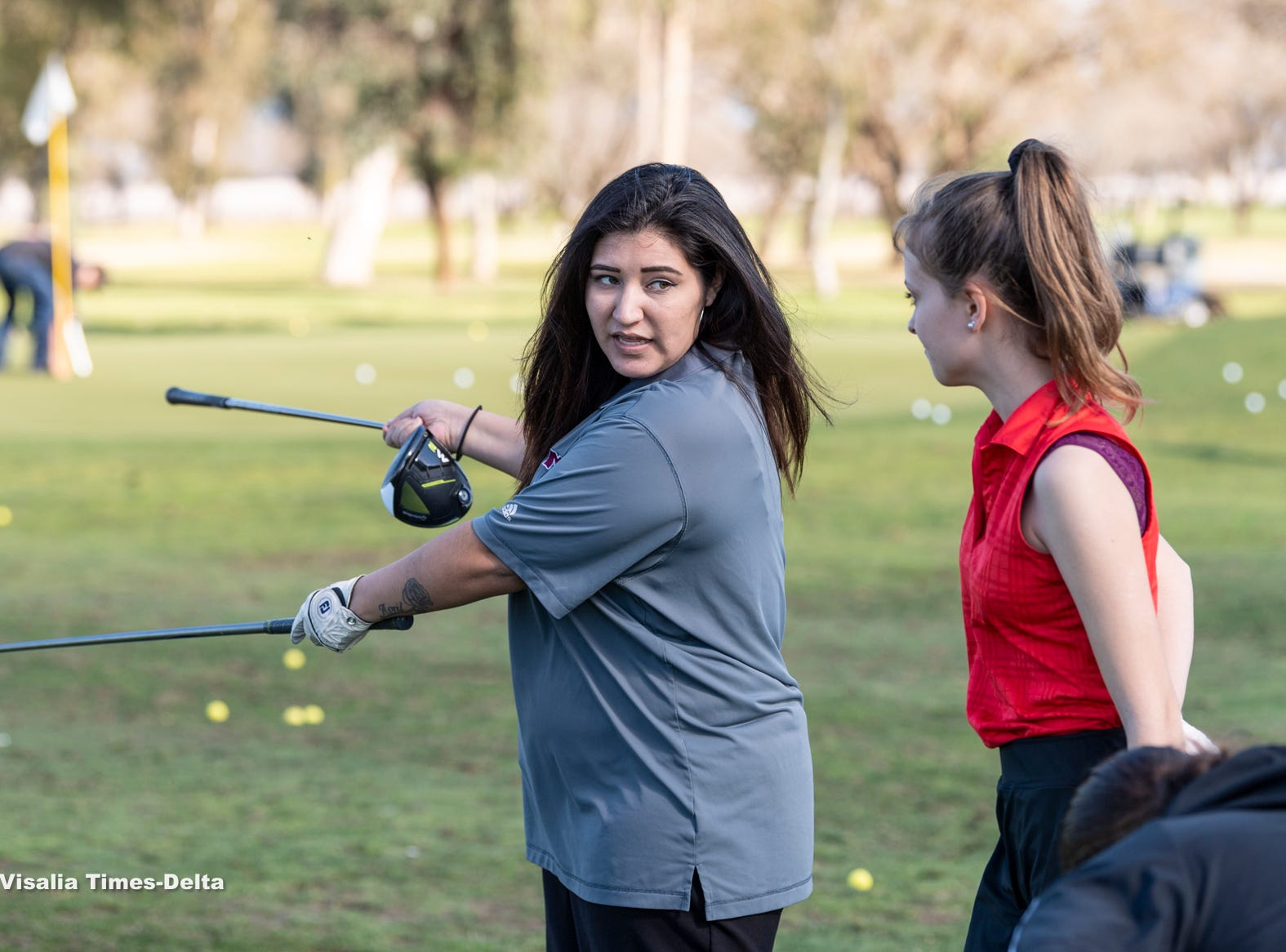 Training professionals from Backswing Golf Events and Fresno State women's golf coaches work with female golfers of all ages on Thursday, February 28, 2019. Organizers held the free event at the Tulare Golf Course to help grow the game of golf in the Central Valley.