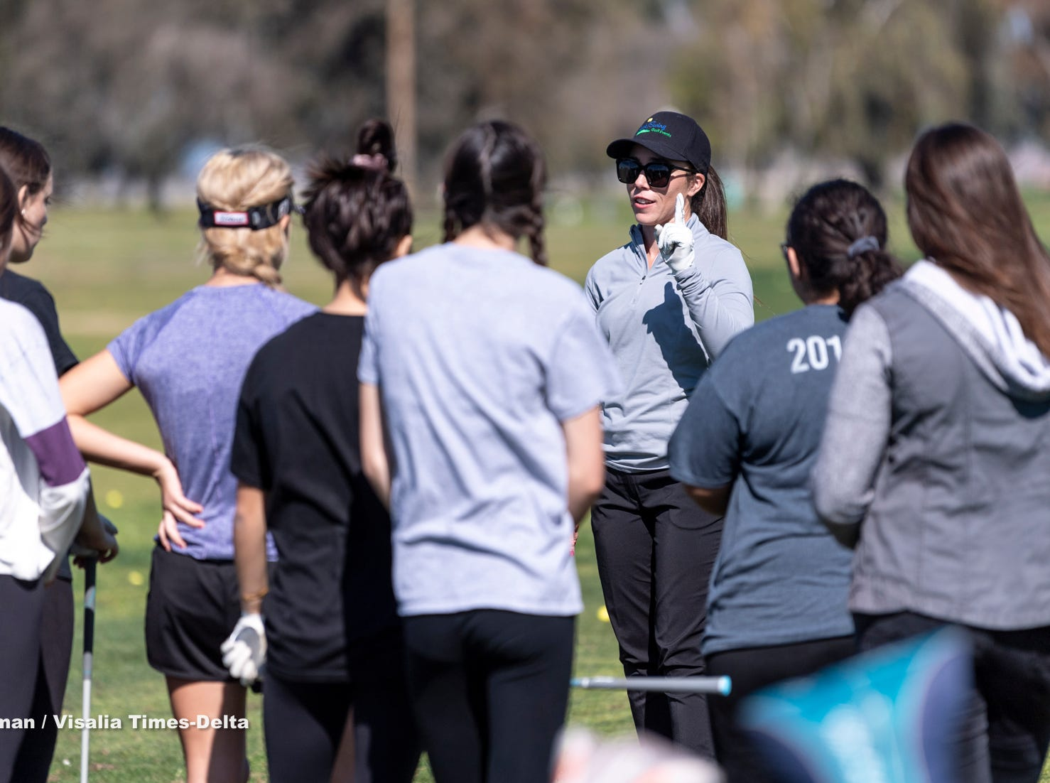Touring golf professional and instructor Amanda Robertson from Backswing Golf Events works with high school golfers on Thursday, February 28, 2019. Organizers held the free event at the Tulare Golf Course to help grow the game of golf in the Central Valley.