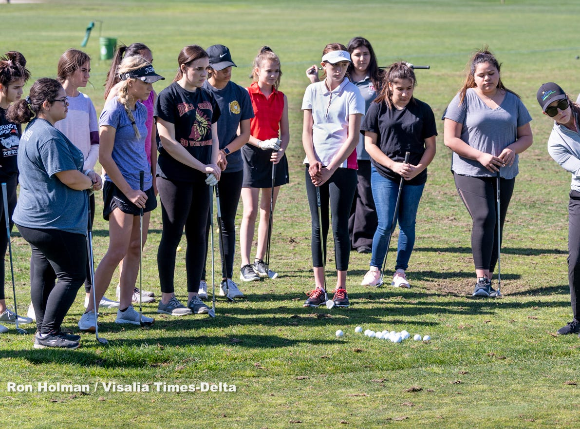 Touring golf professional and instructor Amanda Robertson, right, from Backswing Golf Events works with high school golfers on Thursday, February 28, 2019. Organizers held the free event at the Tulare Golf Course to help grow the game of golf in the Central Valley.