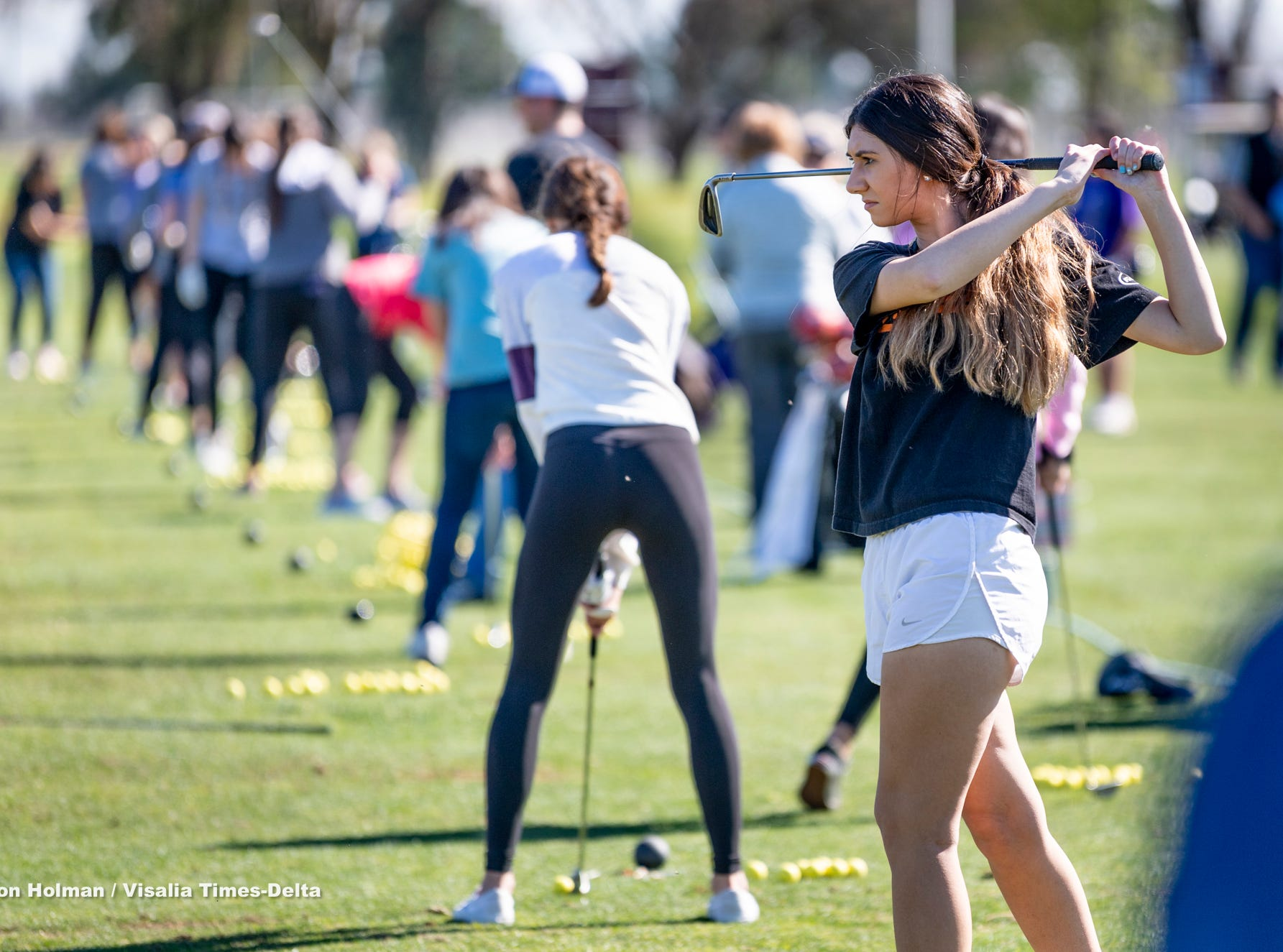 Tulare Western's Carsen Reed watches her shot during a clinic with training professionals from Backswing Golf Events and Fresno State women's golf coaches on Thursday, February 28, 2019. Organizers held the free event at the Tulare Golf Course to help grow the game of golf in the Central Valley.