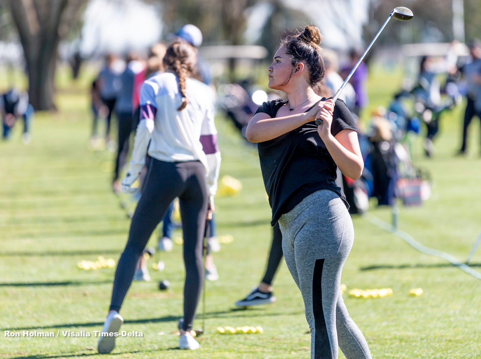 Tulare Western's Sophie Boeve watches her shot during a clinic with training professionals from Backswing Golf Events and Fresno State womenÕs golf coaches on Thursday, February 28, 2019. Organizers held the free event at the Tulare Golf Course to help grow the game of golf in the Central Valley.