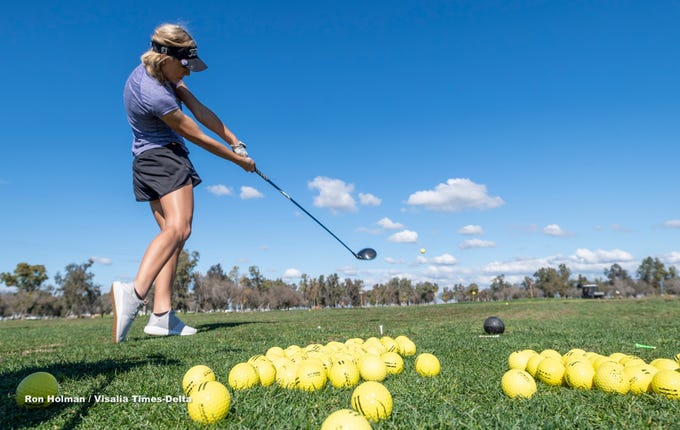 Tulare Union's Jazzy McIntosh drives on the range during a training clinic with professionals from Backswing Golf Events and Fresno State women's golf coaches on Thursday, February 28, 2019. Organizers held the free event at the Tulare Golf Course to help grow the game of golf in the Central Valley.