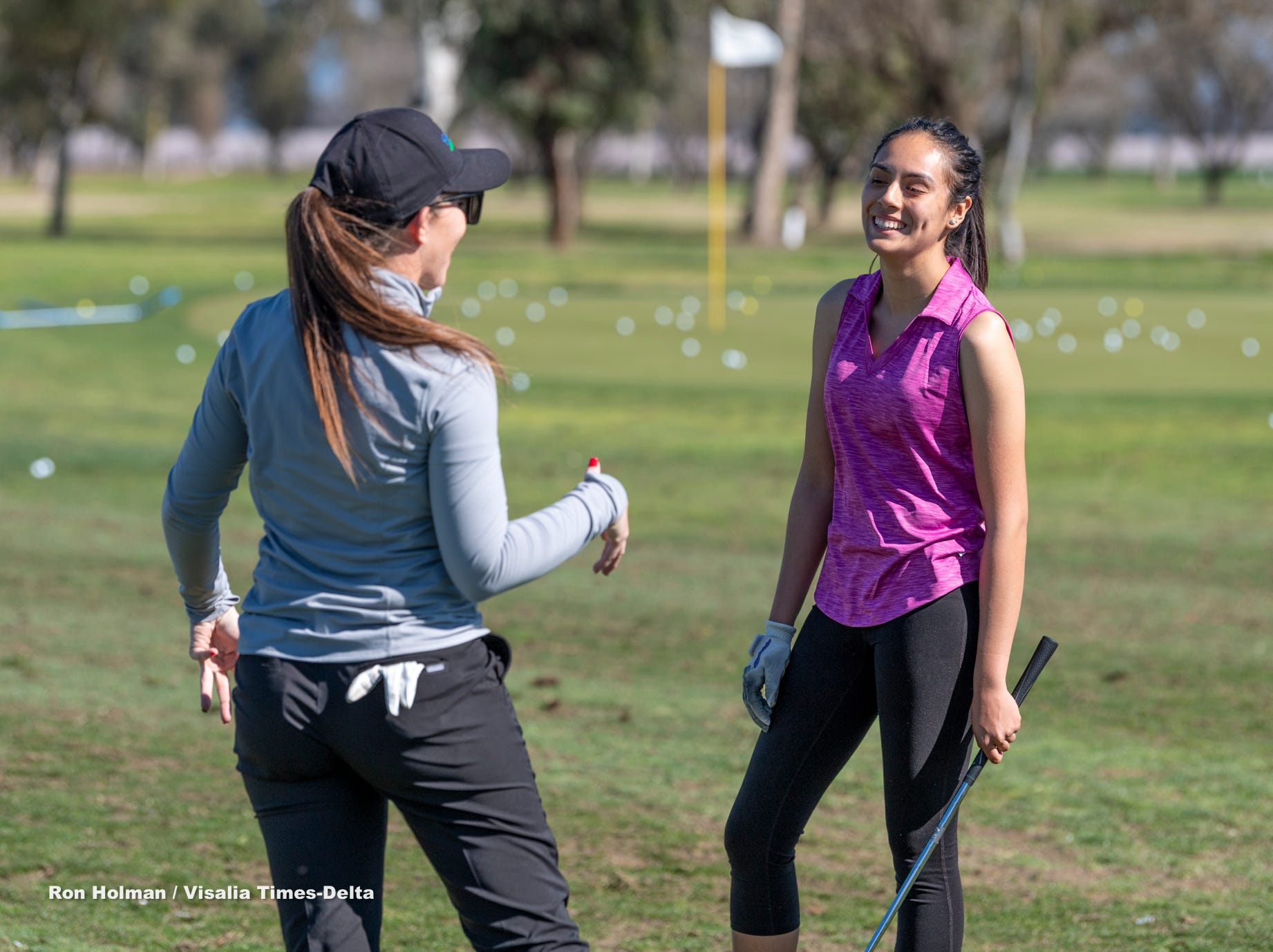 Mission Oak's Yasmin Guerrero, right, listens to professional golfer Amanda Robertson from Backswing Golf Events during a clinic for female golfers Thursday, February 28, 2019. Organizers held the free event at the Tulare Golf Course to help grow the game of golf in the Central Valley.