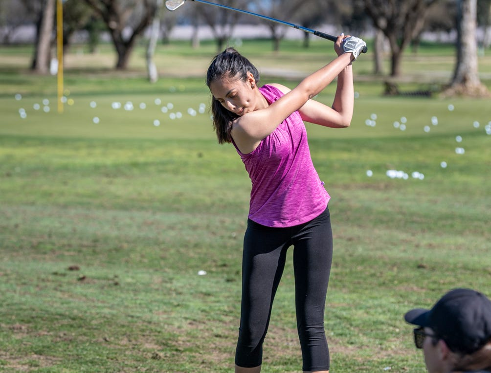 Professional golfer Amanda Robertson, right, works with Mission Oak's Yasmin Guerrero during a clinic for female golfers Thursday, February 28, 2019. Organizers held the free event at the Tulare Golf Course to help grow the game of golf in the Central Valley.
