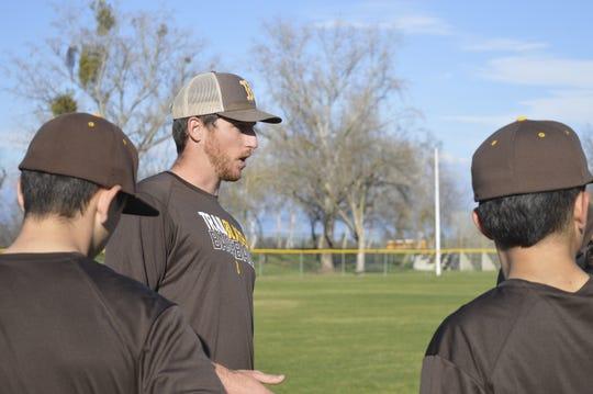Golden West High School baseball head coach Brent Hall directs a practice on Thursday at Dick Doepker Field