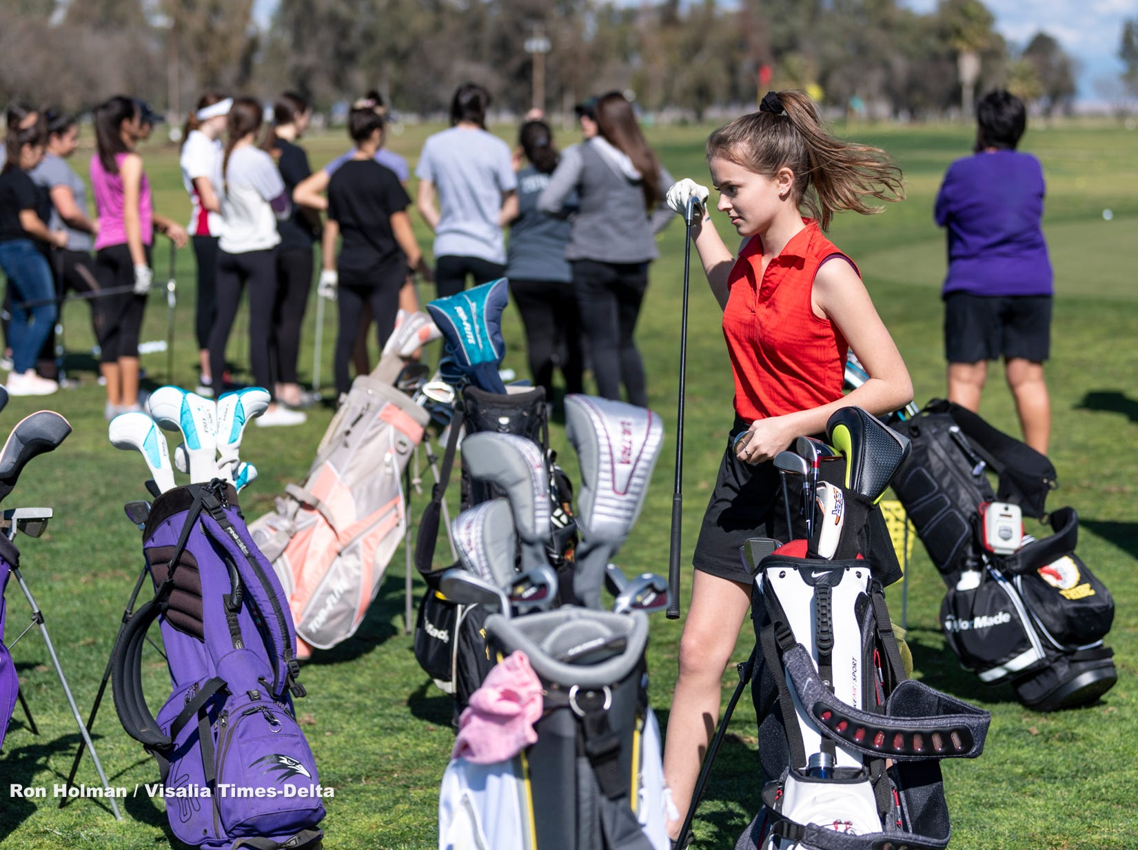 Mt. Whitney's Chloe Jennings selects a club as training professionals from Backswing Golf Events and Fresno State women's golf coaches work with female golfers of all ages on Thursday, February 28, 2019. Organizers held the free event at the Tulare Golf Course to help grow the game of golf in the Central Valley.