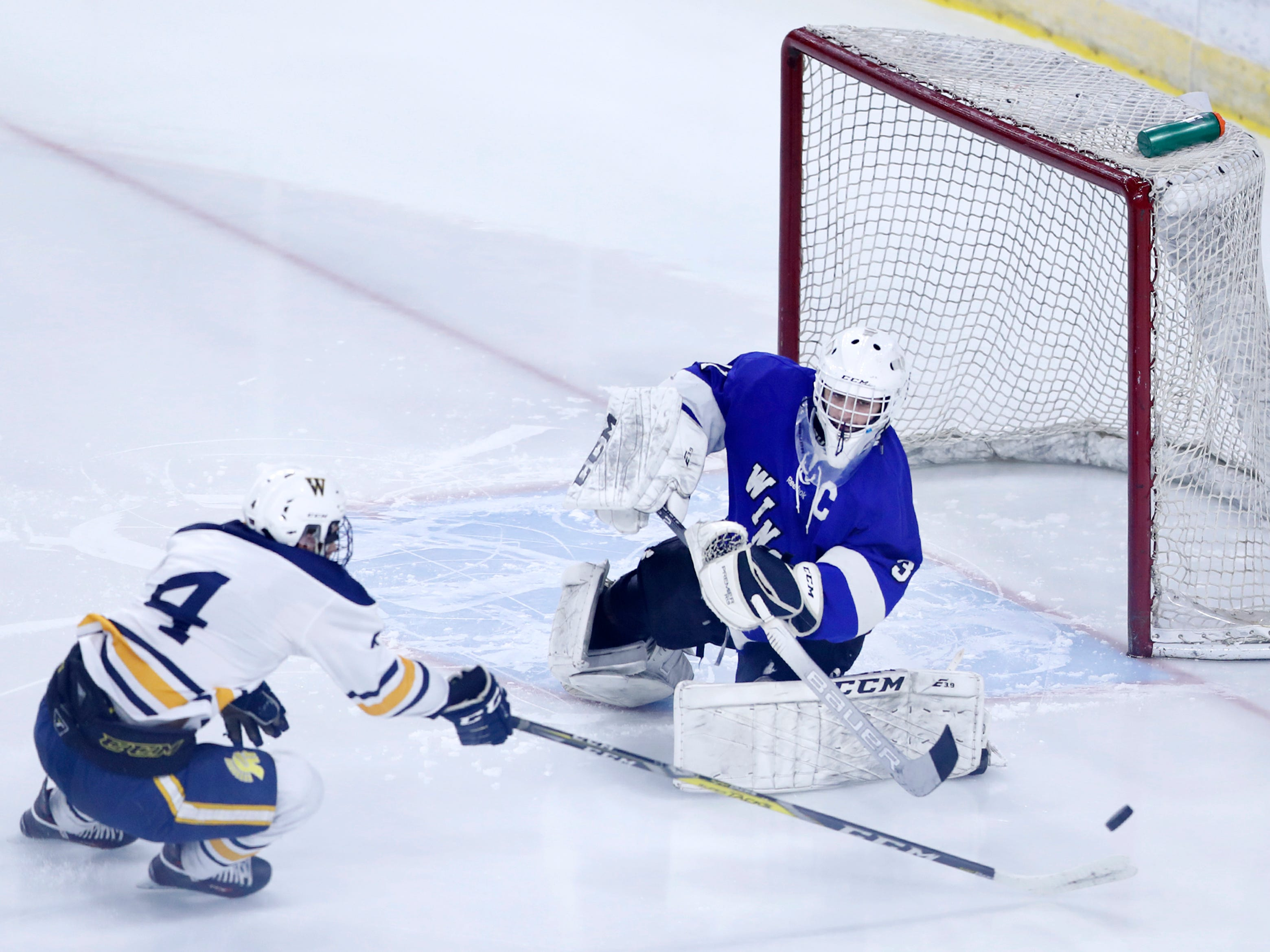 Wausau West's Marc Sippel tries to sneak the puck past Waukesha North Co-op's Garrett Larsen during the WIAA State Hockey Tournament quarterfinals Thursday, Feb. 28, 2019, at Veterans Memorial Coliseum in Madison, Wis.